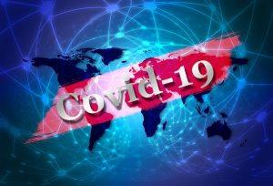 Maailmankartta jonka päällä lukee Covid 19